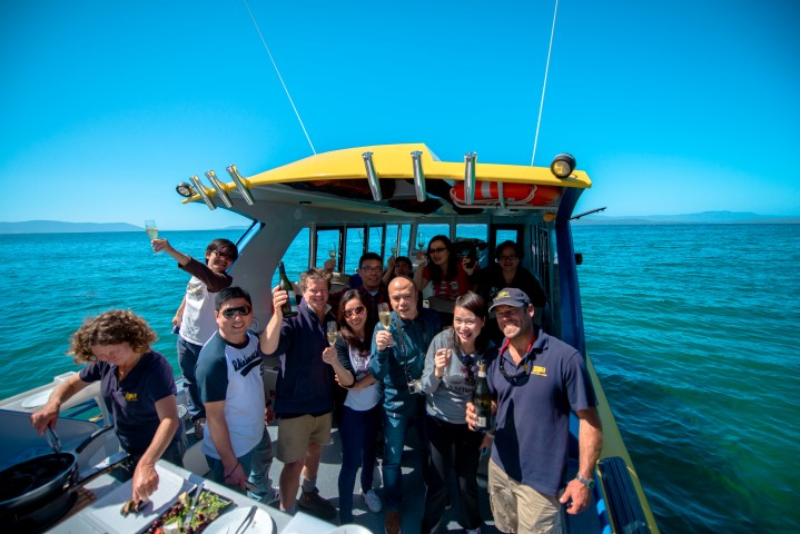 Group enjoying lunch aboard Tasmanian Seafood Seduction